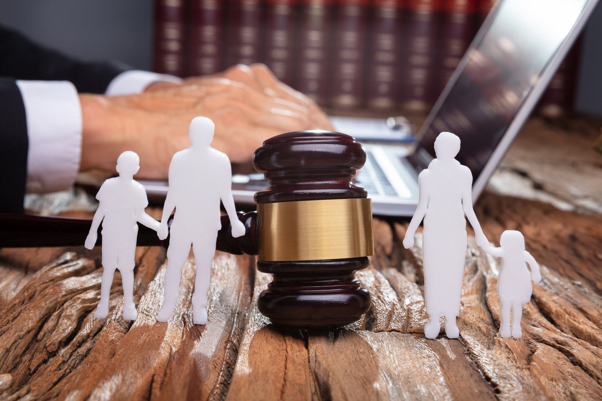 Separation Of Family Silhouette With Gavel